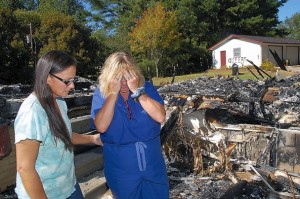 "Tennessee couple, Laura and Carol Ann Stutte, whose home was burned to the ground and whose garage was spray-painted with the word ""QUEERS."""